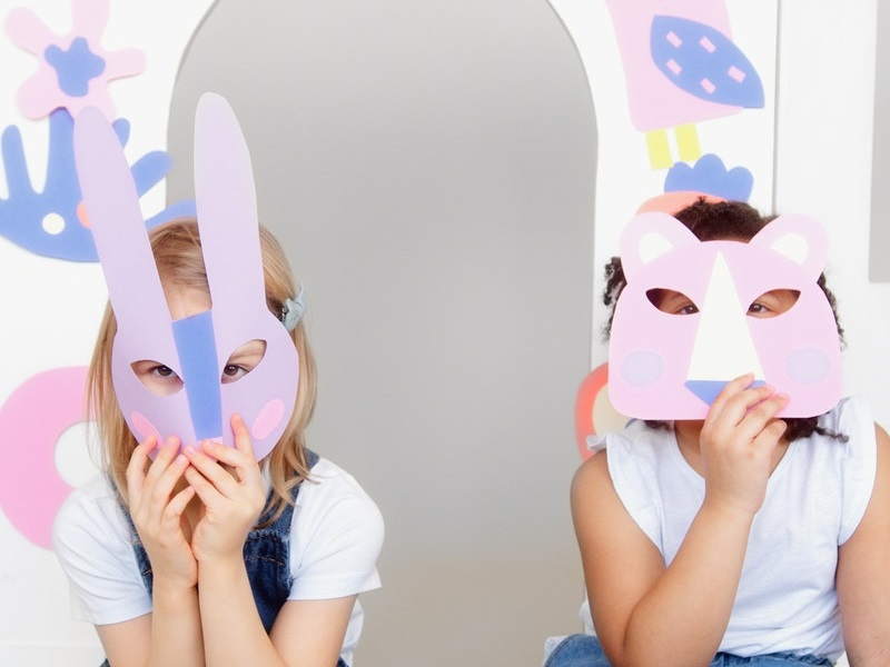 two preschoolers with spring crafts